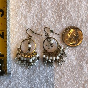 White and brass dangle earrings